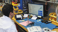 One of our lab technicians calibrating an instrument for a customer